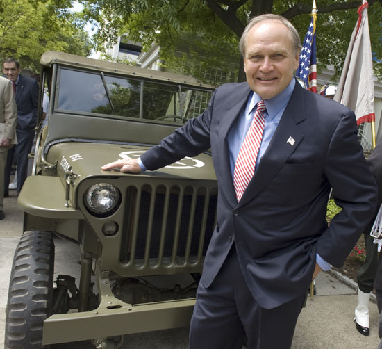 Bob Nardelli leaning on front of the Jeep