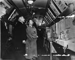 Photograph of Empress Nagako visiting a traveling public health exhibit, which was set up on a train